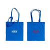 Niebieskie torby na zakupy z białym i czerwonym logo HAY